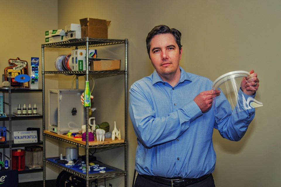Newmarket business owner, Jeff Mayhew of Design Plastics International, shows the first prototype of the face shield made to help in the fight against COVID-19. Dave Kramer for NewmarketToday.