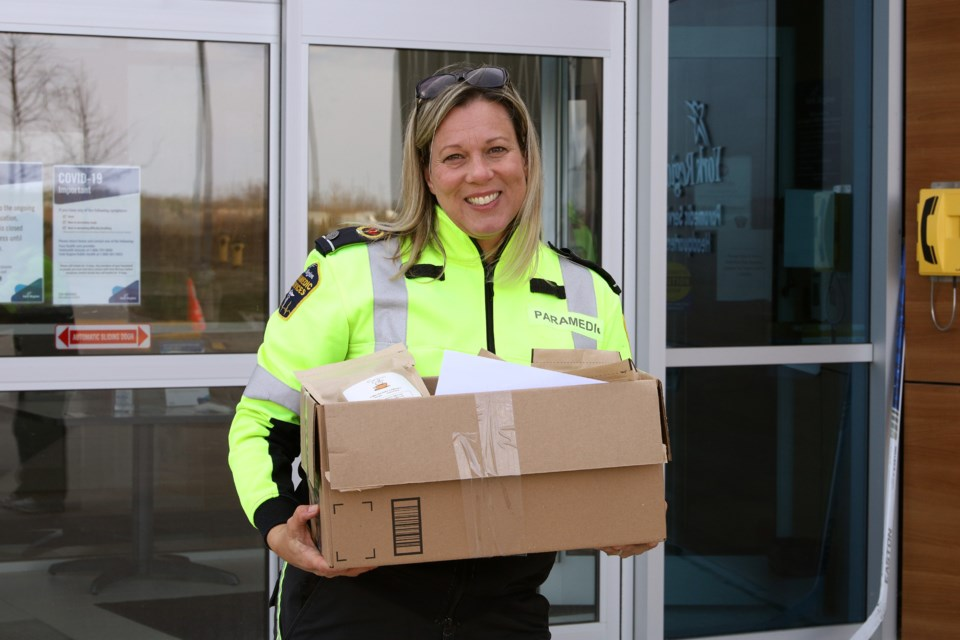 York Region Paramedic Services' Jennifer Whitworth is happy to receive the donation of coffee from Commons Coffee and Catering April 17 in Sharon.  Greg King for NewmarketToday