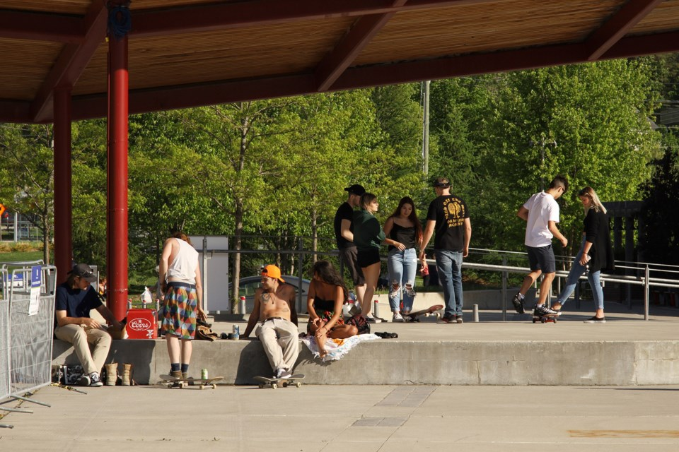 Some young people hang out at Riverwalk Commons in downtown Newmarket.  Greg King for NewmarketToday