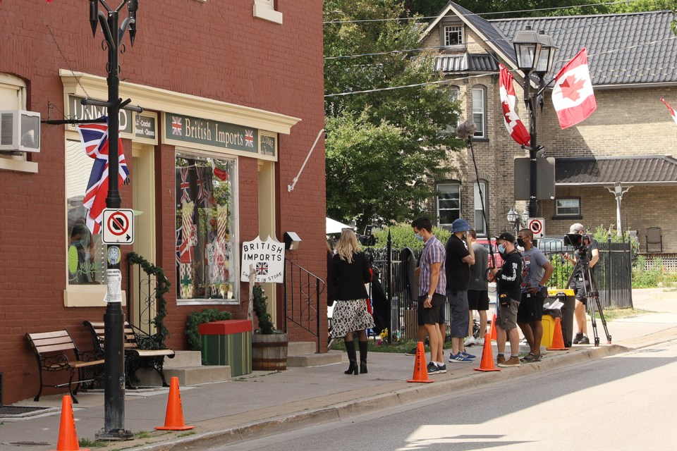 Brain Power Studio film production crews were on the sidewalk outside the British Imports store on Timothy Street at Main today.  Greg King for NewmarketToday