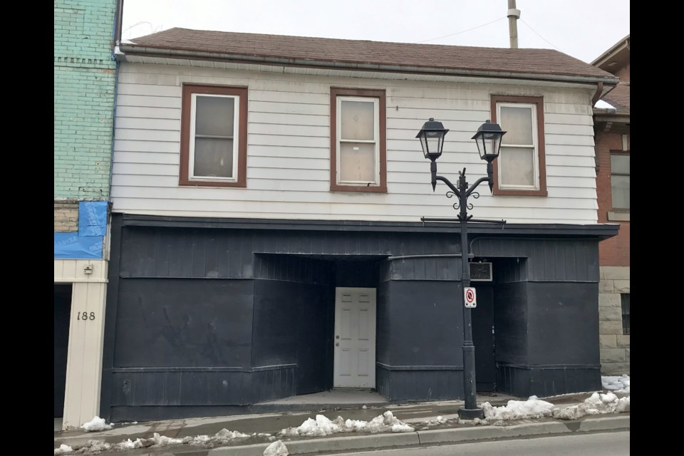 The historic Charles Hargrave Simpson building on Main Street has been boarded up and neglected.