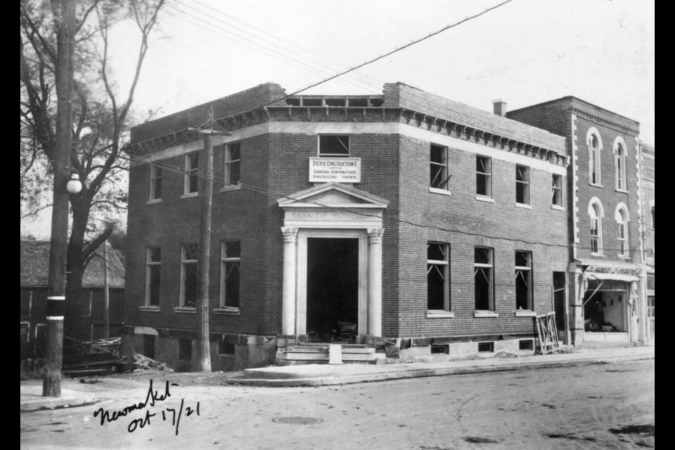The Bank of Montreal branch being built on the corner of Main and Timothy streets in 1921 — now it's a bike shop.