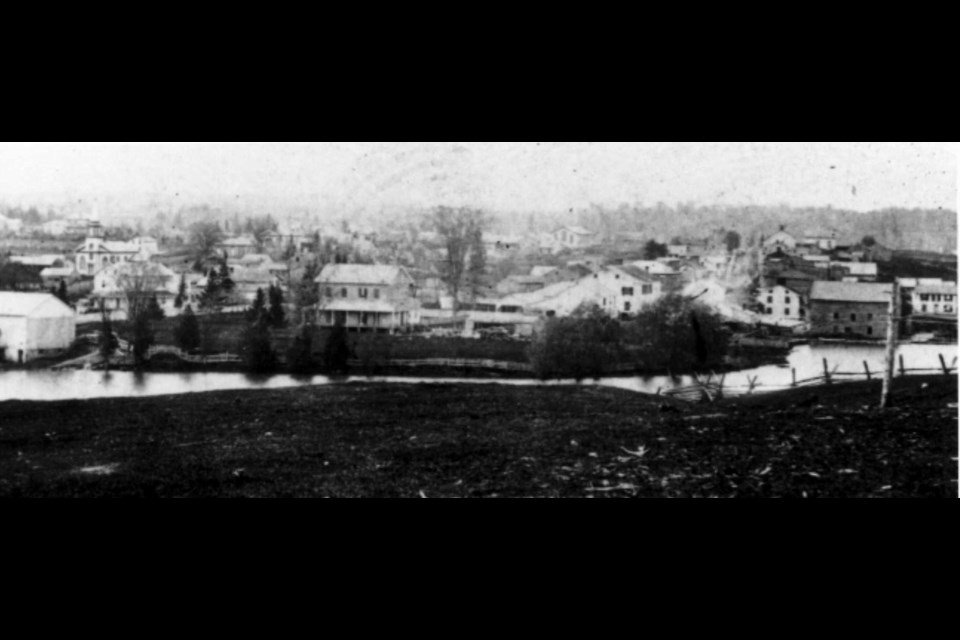 The earliest photograph of Newmarket, 1862, when it was a frontier town with a muddy Main Street — and the forest visible in the background.