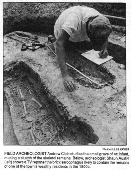 An archeologist studies the remains following their unearthing in 1989.