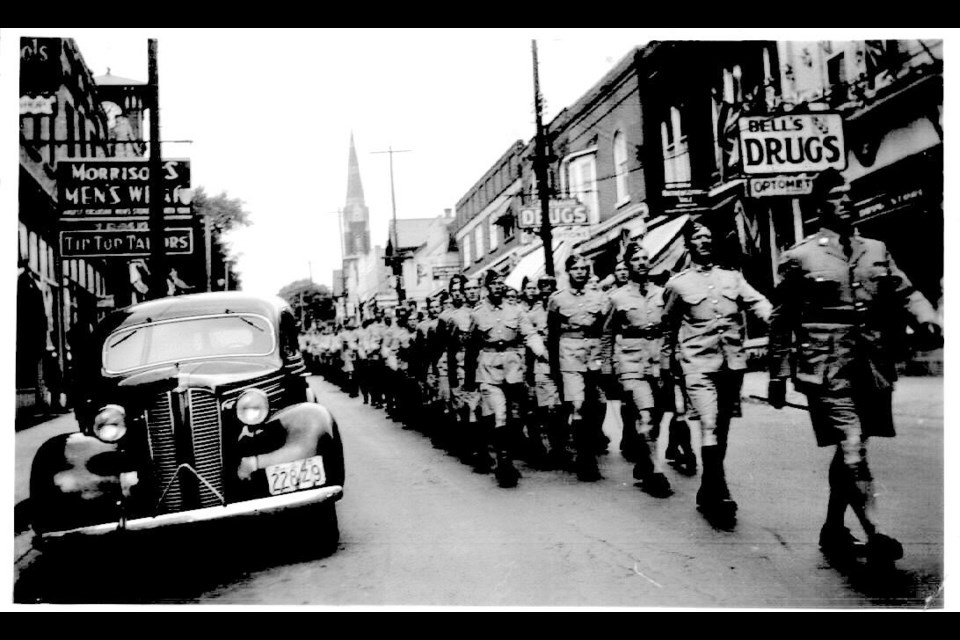 On arriving in Newmarket by train for basic training at the military camp, soldiers marched along Main Street.