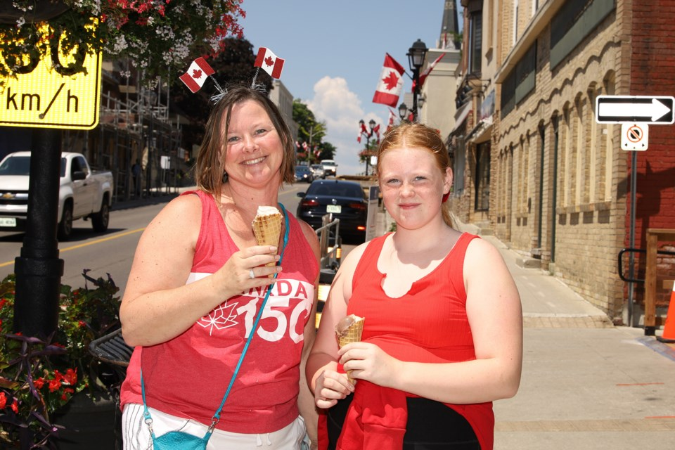 Now: Jodi Burch and daughter Brooke always celebrate Canada Day on Main Street, which was quiet this year due to COVID-19.  Greg King for NewmarketToday