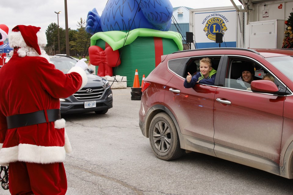 Santa Claus asks passing little boys and girls if they've been good, at the Town of Newmarket's Santa Lane Saturday, Nov. 21 at Ray Twinney Recreation Complex.  Greg King for NewmarketToday