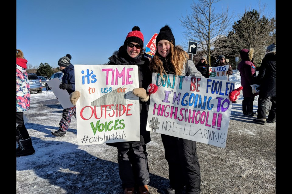 Newmarket mother Ann-Marie Hulse and daughter Teagan raise their voices Jan. 20 on the picket line at Stonehaven Elementary School. Kim Champion/NewmarketToday