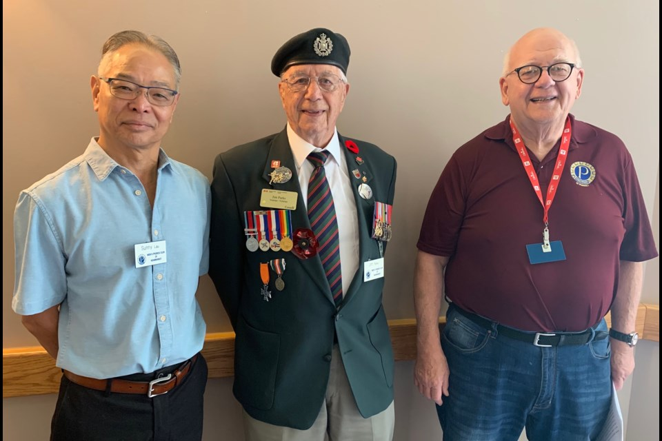 The Men's PROBUS Club of Newmarket paid tribute to Second World War veteran and longtime club member Jim Parks (centre), here with president Sunny Lau and member Doug Wigglesworth. Debora Kelly/NewmarketToday