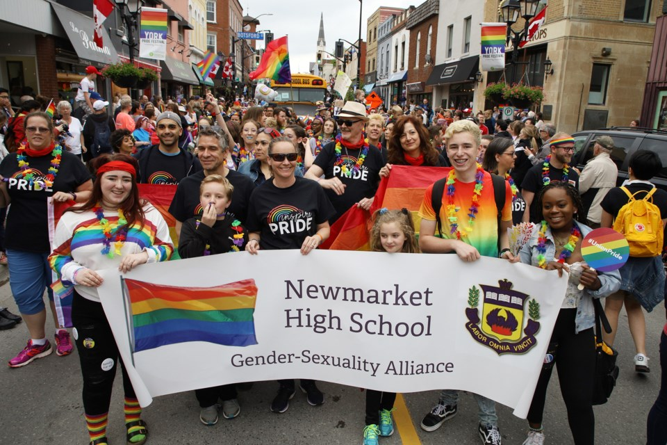 Newmarket High School students celebrate York Pride on June 13 in the annual parade on Main Street Newmarket. File photo/Greg King for NewmarketToday