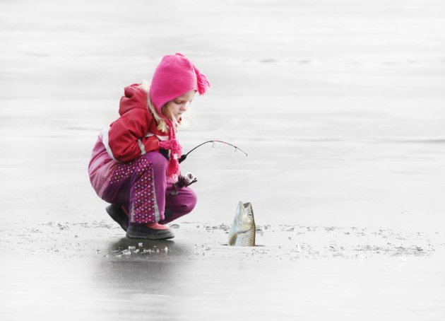 fish girl ice fishing stock