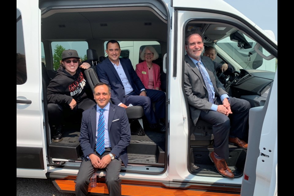 Trying out one of the new AS York D.A.Y. program vans is James Wladyzak (from left), Elaine Adam of the Ontario Trillium Foundation (back), Aurora-Oak Ridges-Richmond Hill MPP Michael Parsa, AS York board chair Zahid Salman, driver Patrick Kwan, and AS York CEO Loren Freid. Debora Kelly/NewmarketToday