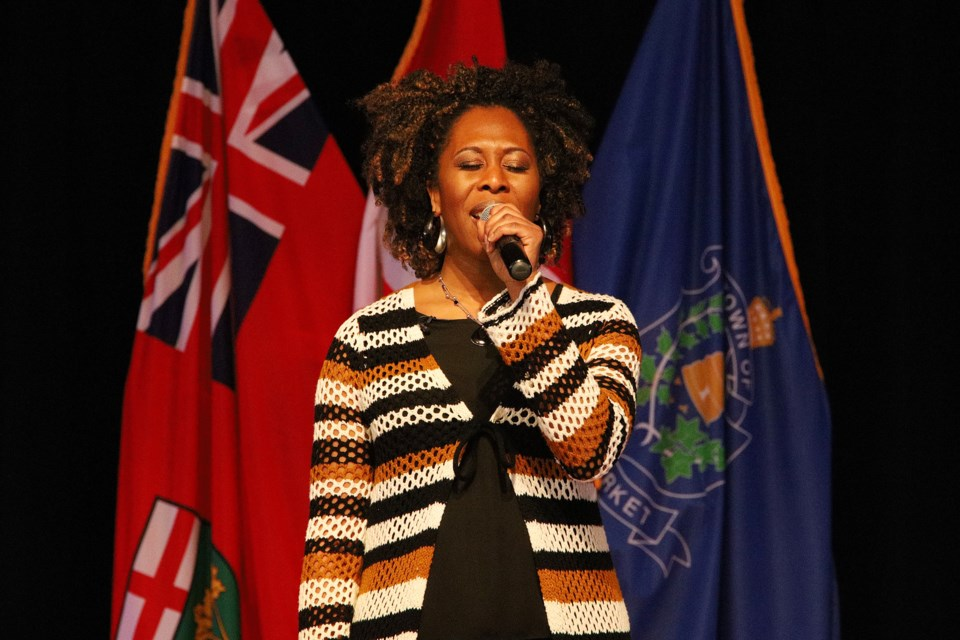 Quisha Wint sings the national and Black anthems at the Black History Month event presented by the Newmarket African Caribbean Canadian Association (NACCA) and the Town of Newmarket Feb. 8.  Greg King for NewmarketToday
