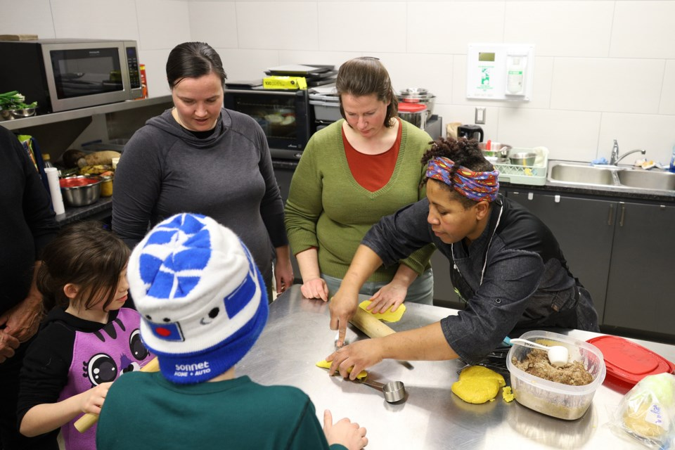 Chef Maxine Knight, culinary program director for York Region Food Network, shows how to make Jamaican patties at an evening of Afro-Caribbean cooking and storytelling at the Newmarket Recreation Youth Centre and Sk8te Park Feb. 21.  Greg King for NewmarketToday