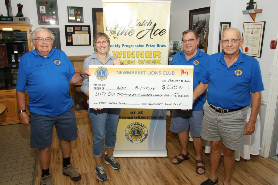 Anne McIntyre picks up her cheque for $61,895 from the Newmarket Lions Club.  Kirby Brock, Anne McIntyre, Ron Head, and Rick Metcalfe.  Greg King for NewmarketToday