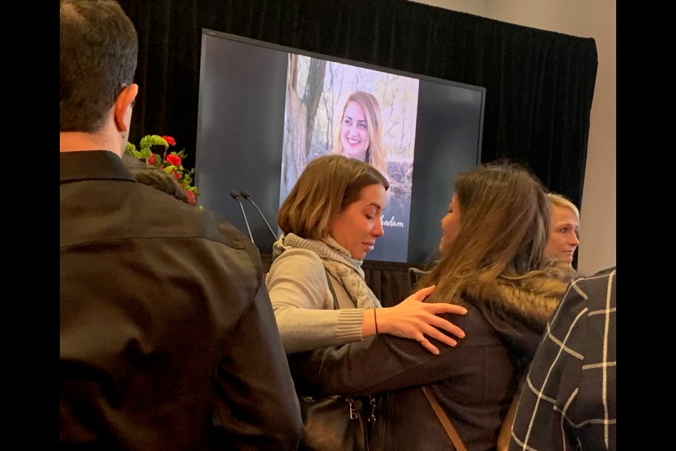 Hugs and tears are shared following the service Jan. 13 at the Region of York for Iran plane crash victim Bahareh Karami. Debora Kelly/NewmarketToday