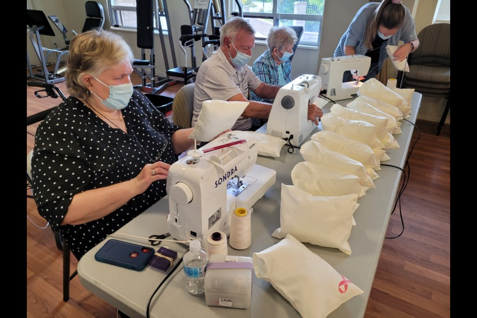 A team of three sewers worked hard to keep up with all the folks filling the pillow cases at Amica Newmarket.