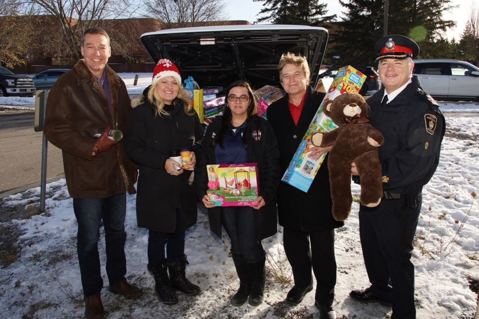 Newmarket Mayor John Taylor (from left), Newmarket Food Pantry director Juliane Goyette, Newmarket Soccer Club sponsorship coordinator Petra Fera, Newmarket Deputy Mayor Tom Vegh, York Regional Police Deputy Chief Brian Bigras mark the official launch of the Holiday Heroes toy and food drive Sunday at the Newmarket Soccer Club.  Greg King for NewmarketToday