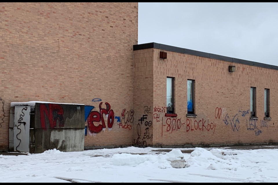 Almost an entire wall at the side of St. Paul Catholic Elementary School was defaced with offensive graffiti. Debora Kelly/NewmarketToday