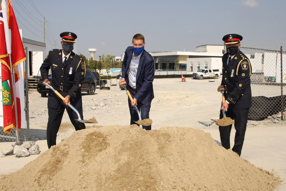 York Regional Police Supt. Kelvin Chantiam (from left), Newmarket Mayor John Taylor, and Police  Chief Jim MacSween officially break ground on the new #1 District station Friday, Sept. 25.  Greg King for NewmarketToday