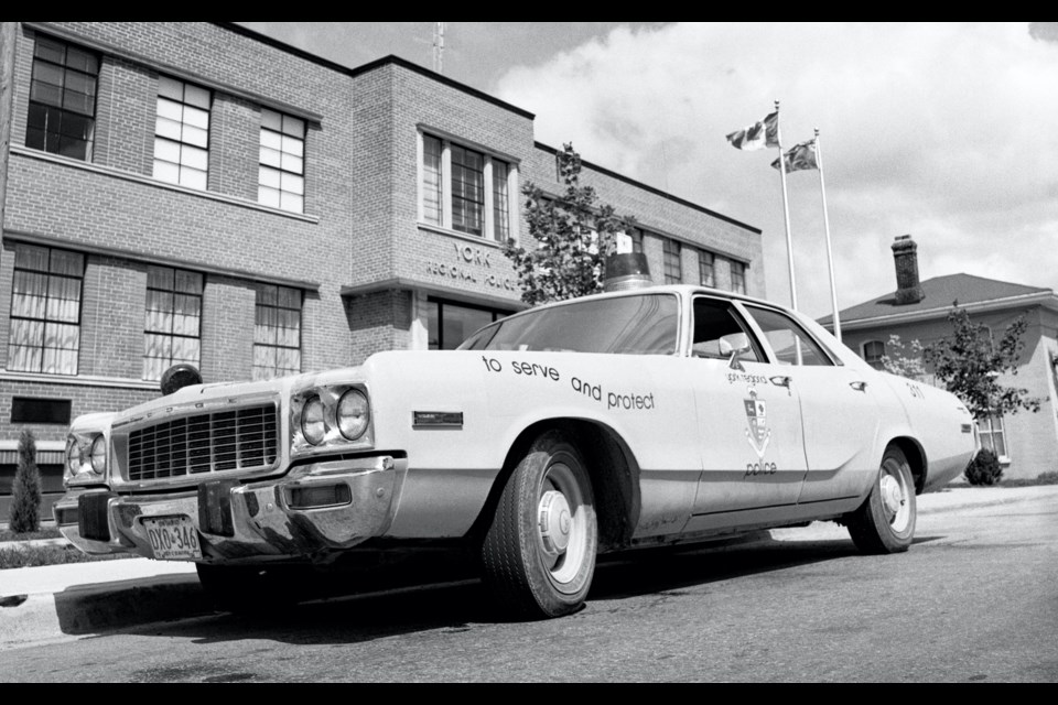 The very first York Regional Police cruiser was a chrome-yellow Dodge Polara, seen here parked in front of York Regional Police headquarters at 240 Prospect St., Newmarket in 1973.