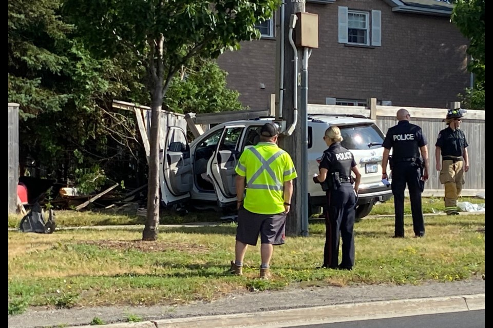 A Newmarket man is now charged in the collision that toppled a backyard fence on Mulock Drive June 14. Allie Kelly for NewmarketToday