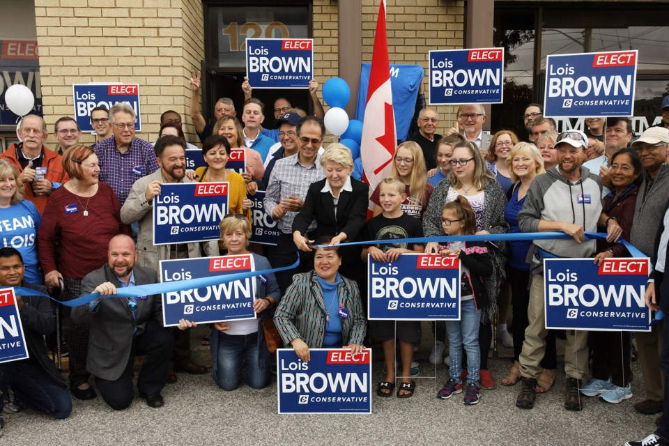 Newmarket-Aurora Conservative federal election candidate Lois Brown cuts the ribbon with her volunteers to formally open her campaign headquarters Saturday at 120 Harry Walker Parkway North in Newmarket.  Greg King for NewmarketToday