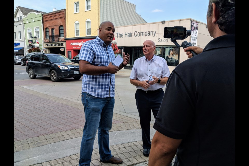 Newmarket-Aurora Liberal candidate Tony Van Bynen is joined Sept. 11 by Don Valley East MPP and Ontario Liberal leadership candidate Michael Coteau for a tour of Main Street to kick off the official start to Canada's 43rd general election. Kim Champion/NewmarketToday