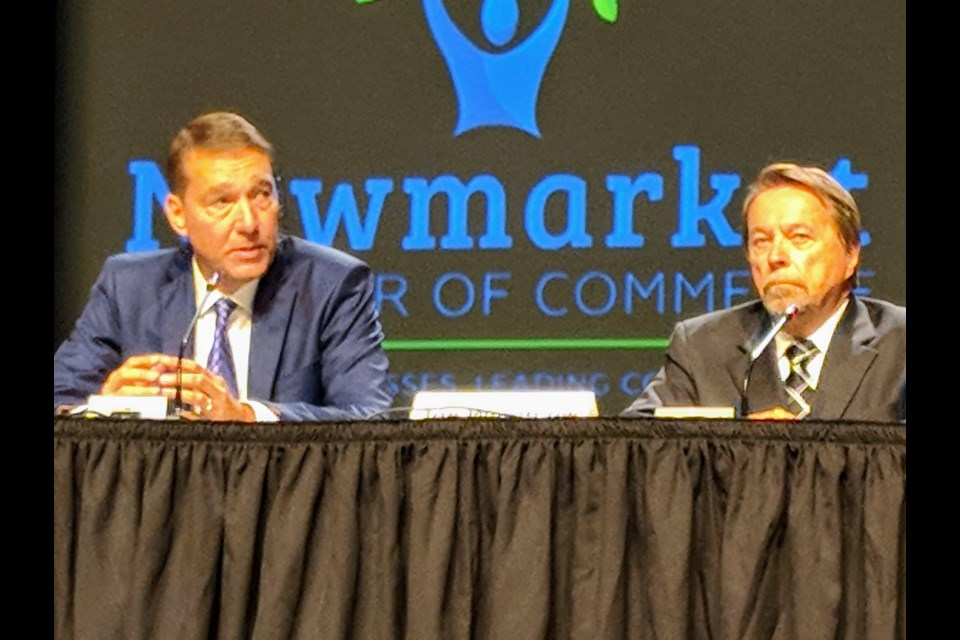 Newmarket mayoral candidates John Taylor (left) and Joe Wamback participated Wednesday night in an election debate hosted by the Newmarket Chamber of Commerce, in partnership with the Toronto Real Estate Board.