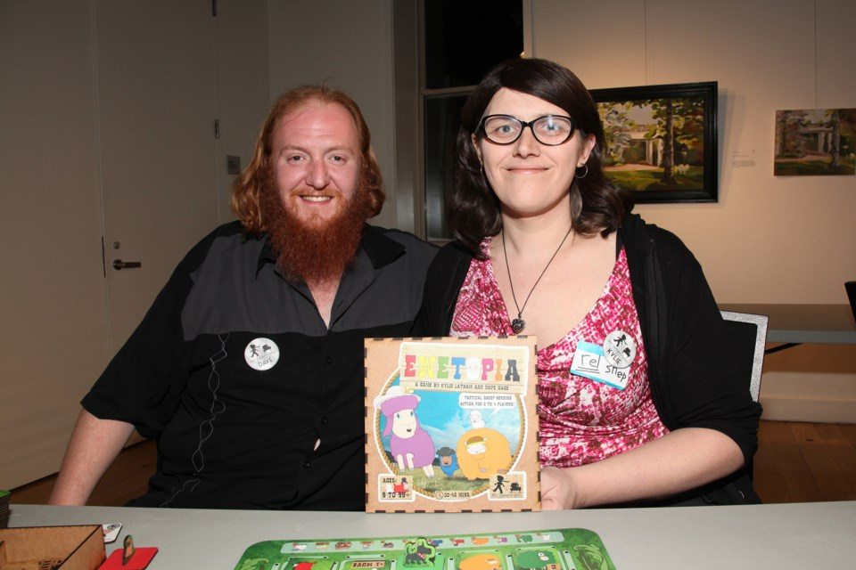 Board game designers Dave Gage and Kylie Latham brought their game, Ewetopia, to the Town of Newmarket's Daring Pairings board game night Saturday.  Greg King for NewmarketToday