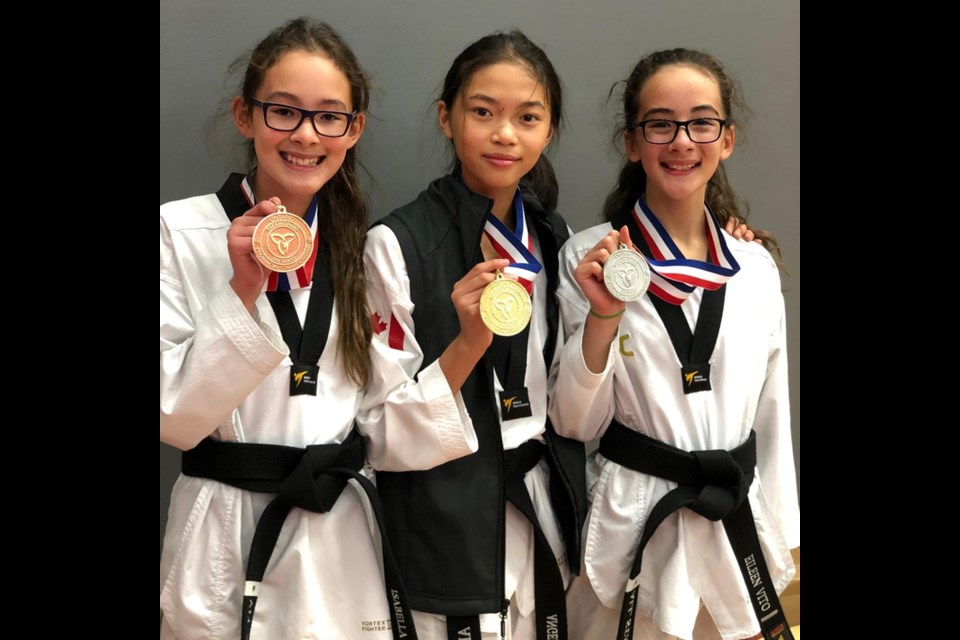 All Star Martial Arts students Isabella Vito, Angelina Lam and Eileen Vito brought home medals from the provincial taekwondo championships in Markham last weekend. Suppied photo/All Star Martial Arts