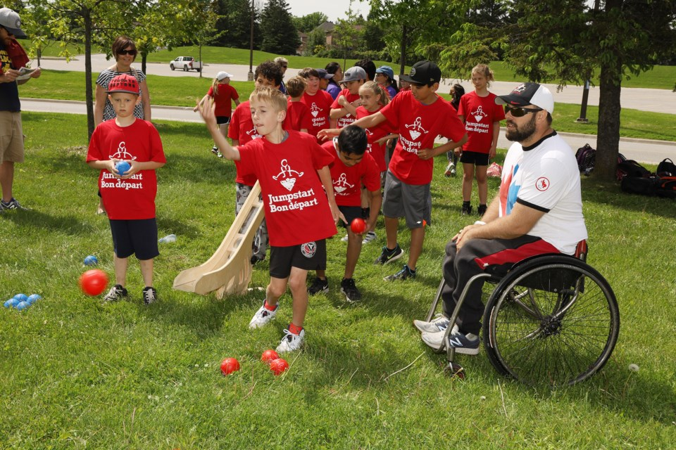 Paralympian Billy Bridges shares tips with the Newmarket students at the Jumpstart Games yesterday at Ray Twinney Recreation Complex.  Greg King for NewmarketToday
