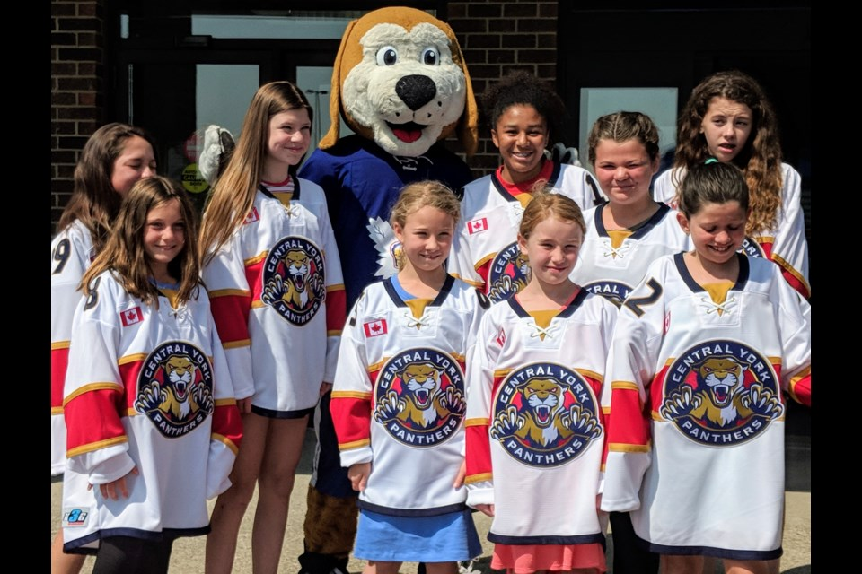 Central York Girls Hockey Association mascot, Duke the Dog, joins some of the organization's players July 25 at the Ray Twinney Recreation Complex in Newmarket. Kim Champion/NewmarketToday