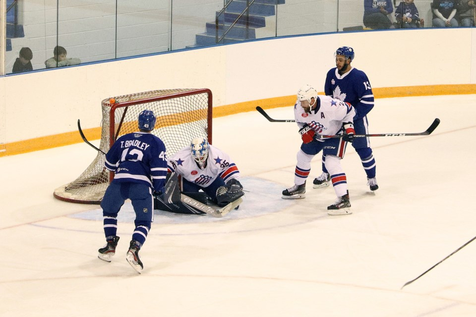 The Rochester Americans goalie blocks a shot by the Marlies' Trey Bradley at yesterday's AHL pre-season game in Newmarket.  Greg King for NewmarketToday