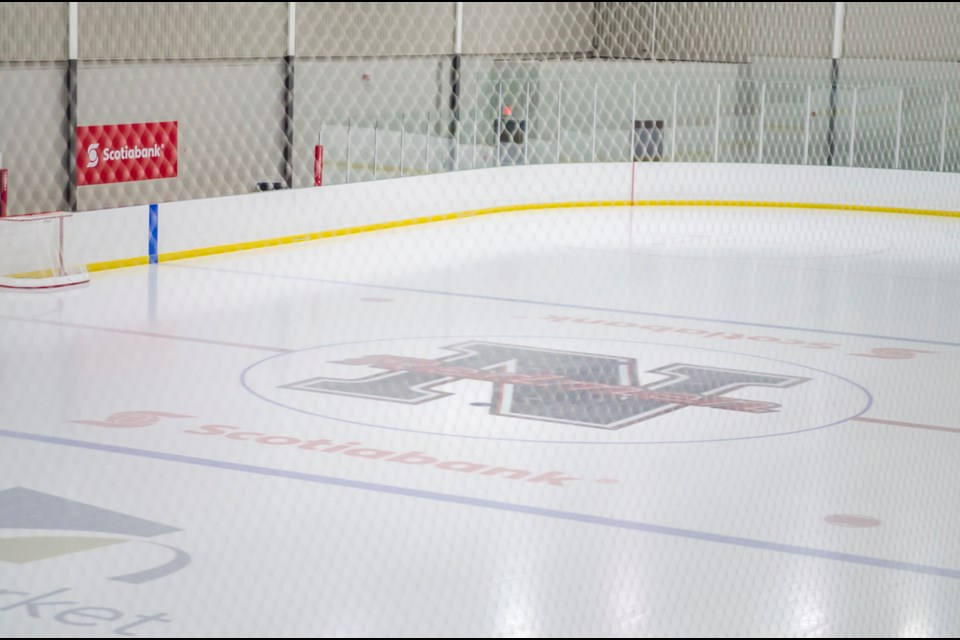 The NMHA Redmen stencil at centre ice will be replaced by next season. Dave Kramer for NewmarketToday