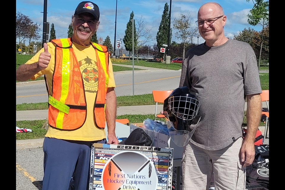 First Nations Hockey Equipment Drive founder Graham McWaters thanks a donor who dropped off a new $400 goalie helmet at the Magna Centre event Sept. 18.