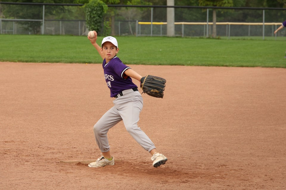The Newmarket Baseball Association held its annual house league tournament last weekend at Armstrong Park. Here, the Purple Team pitcher takes aim.  Greg King for NewmarketToday