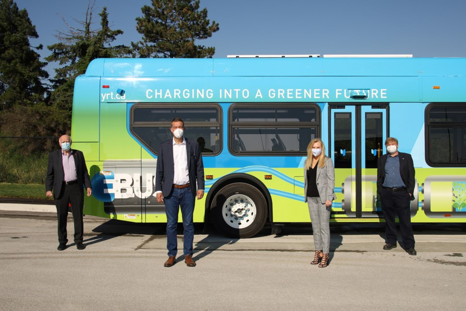 Newmarket-Aurora MP Tony Van Bynen, Newmarket Mayor John Taylor, YRT director of transit operations Ann-Marie Carroll, and Newmarket Regional Councillor Tom Vegh marked the debut of York Region's first electric bus, which has two routes in Newmarket.  Greg KIng for NewmarketToday
