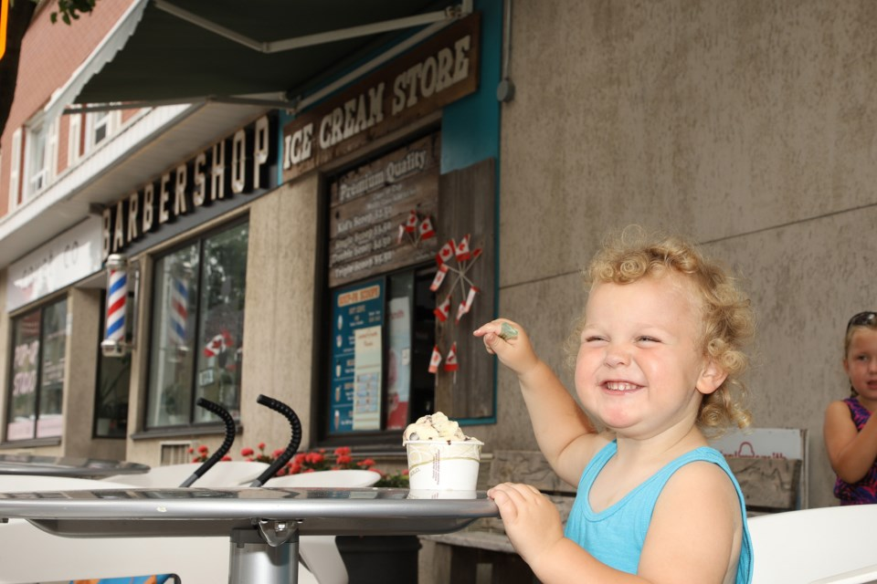 Henry's solution to the heat wave is ice cream on Main Street Newmarket.  Greg King for NewmarketToday