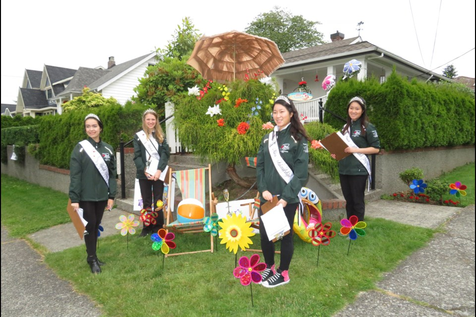 Team Tiara 2020 Lauren, Tianna, Ashley and Alyssa standing with a 2020 Porch Parade entry.