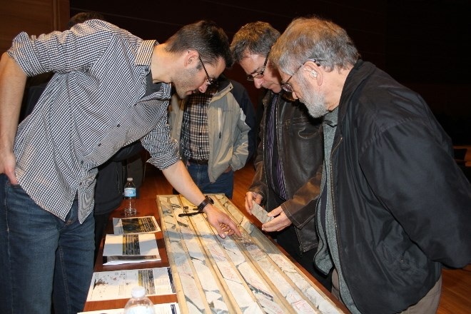 Attila Pentek, left, senior geologist at Wallbridge Mining Company Limited, answers questions on core samples taken from the Fenelon Gold Property in northern Quebec the mining company has been exploring.