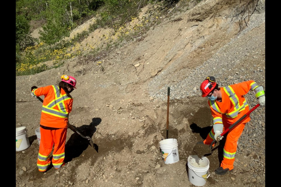 Students and research-assistants Danny-Elle Henri and Brodie Chisholm collecting soil samples on an old aggregate site. (Collège Boréal photo)