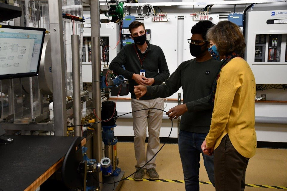 Student Sachin Raj Sampath (centre) demonstrates instrumentation equipment for Confederation College President Kathleen Lynch and Lakeside Team Lead of Regional Services Chris Foulds. (Supplied photo)
