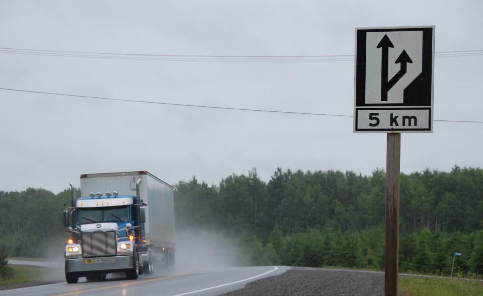 Highway 11 passing lane sign