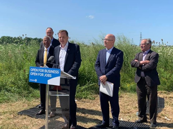 Environment Minister and Elgin-Middlesex-London MPP Jeff Yurek is joined at the podium by his cabinet colleagues John Yakabuski, Victor Fedeli, Steve Clark and Frank Dottori of Element5 in announcing Ontario's first cross-laminated timber plant in St. Thomas.