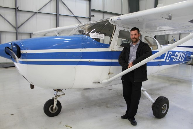 Matt Neumann, chief flight instructor and training coordinator at Discovery Aviation Academy, now Mag Aerospace Canada in Sudbury stands by a Cessna 172, one of the training planes they use to teach students how to fly at the flight school department of the company.