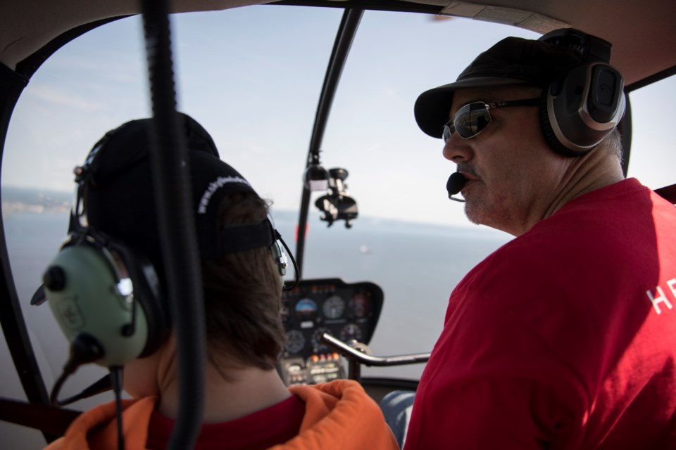 Helicopter pilot Liam Dowds is ready to take tourists and business travellers aloft this summer with a new touring company coming to Thunder Bay's waterfront. (Photos courtesy of Damien Gilbert/Epica Pictures)