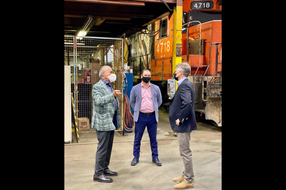 Provincial Finance Minister Rod Phillips (r) chats with Milad Mansour (l) and Jason Carriere at the Diesel Electric Services locomotive shop in Sudbury.(Supplied photo)