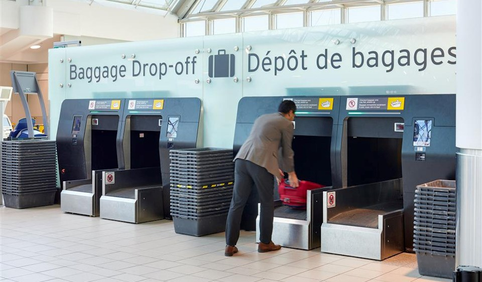 The post-pandemic look of airports will emphasize practices like self-serve baggage drop-offs to reduce contact with airport staff. (Photo by Tom Arban, courtesy of Stantec)