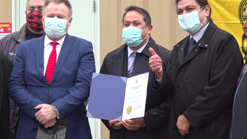 From left, Dent-X Canada president Jimmy Emms, First Nations Procurement Inc. president Matthew Owl, and Wiikwemkoong Chief Duke Peltier celebrated the official opening of a new FN95 mask manufacturing facility on Nov. 26. (Screen capture courtesy FirstTel Communications Corp.)
